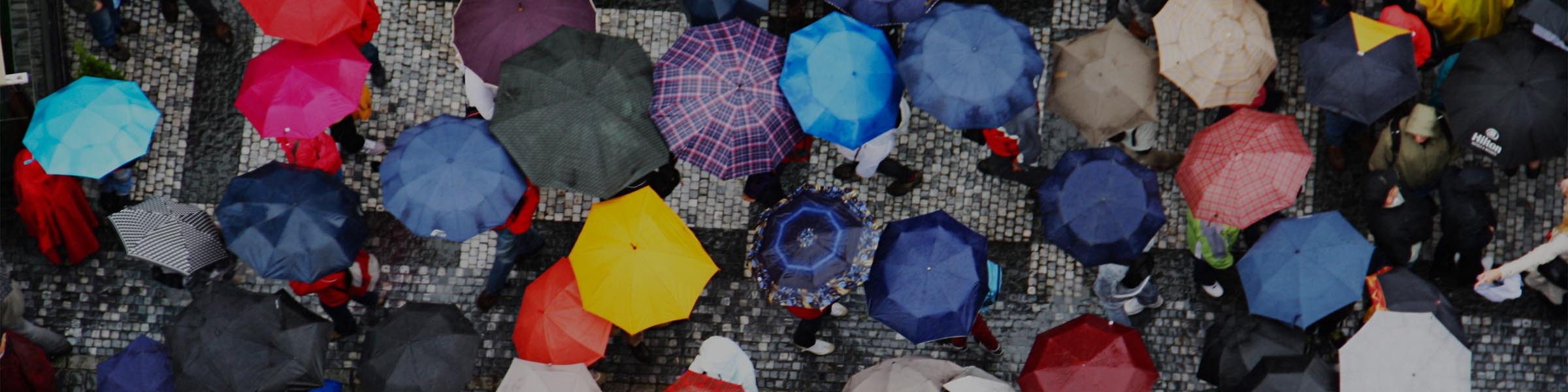 617926557_Macro_People_Standing_Umbrellas__Street_Monsoon