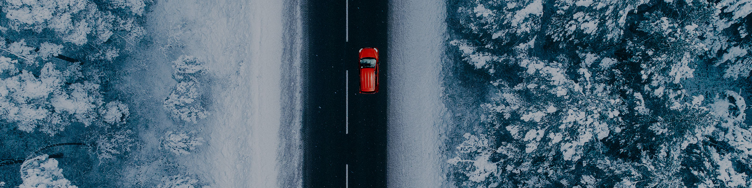 898903008-VF-Business-Macro-Aerial-view-snow-road-red-car