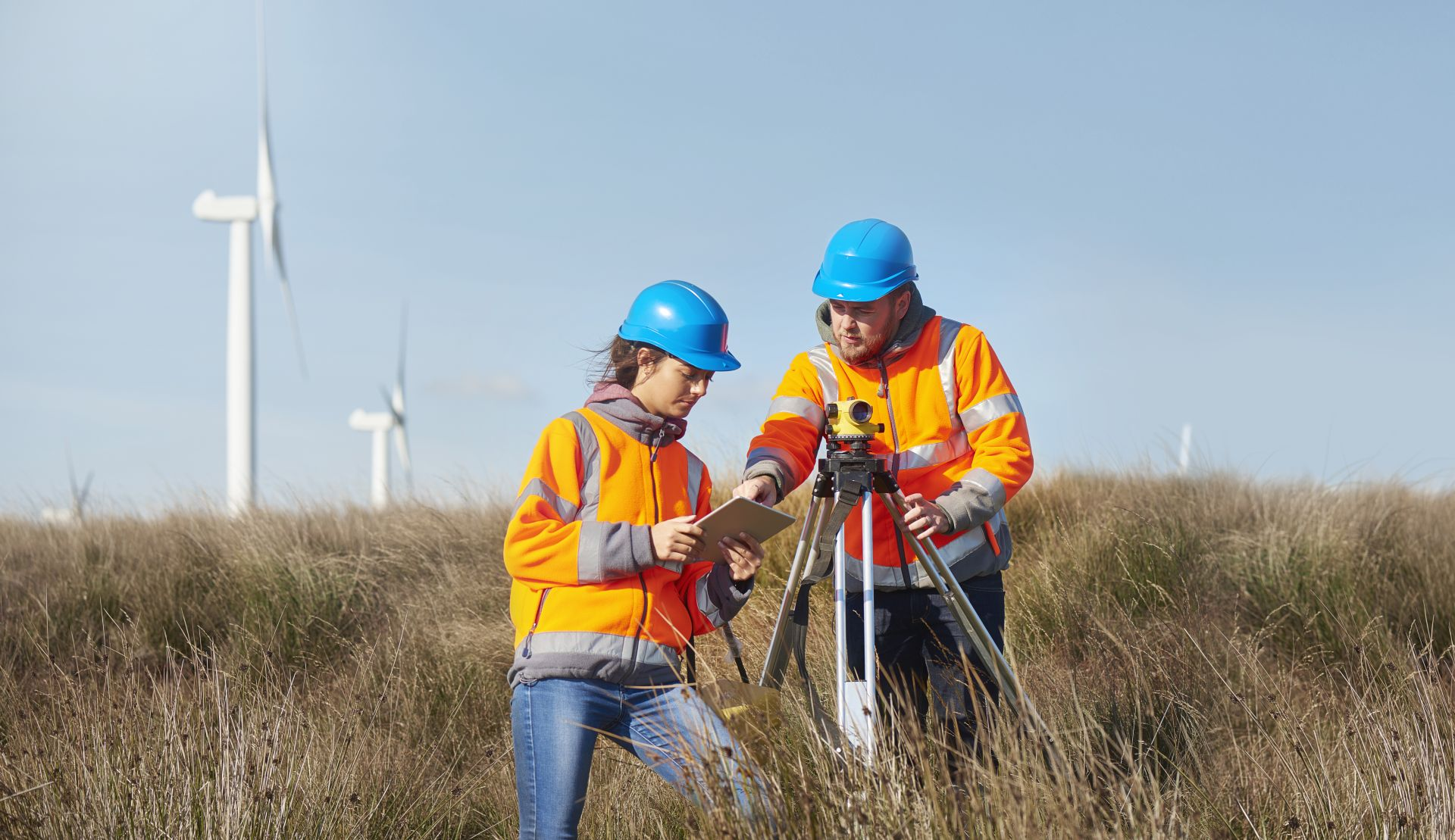 Vodafone Business - Hero - Two People In Wind Farm Field